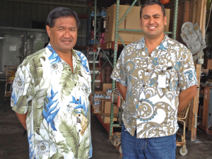 The Food Basket's Marshall Akamu (left), operations manager for North and West Hawai'i, and executive director En Young at the organization's warehouse in Kailua-Kona. (Photo courtesy The Food Basket)